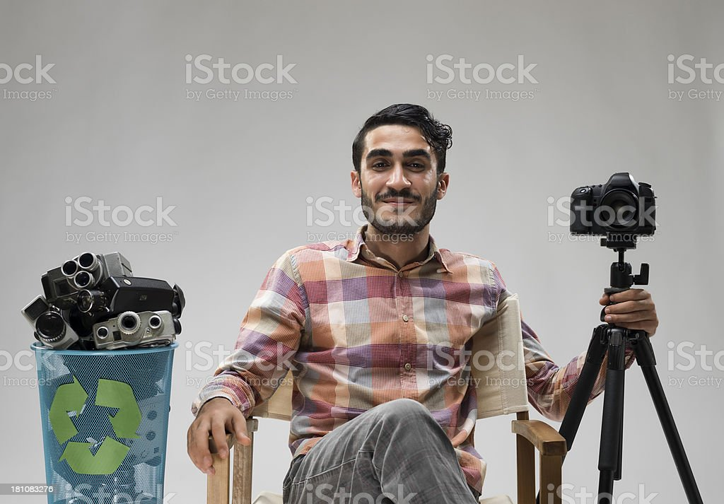 Film director posing with his new digital SLR camera, royalty-free stock photo