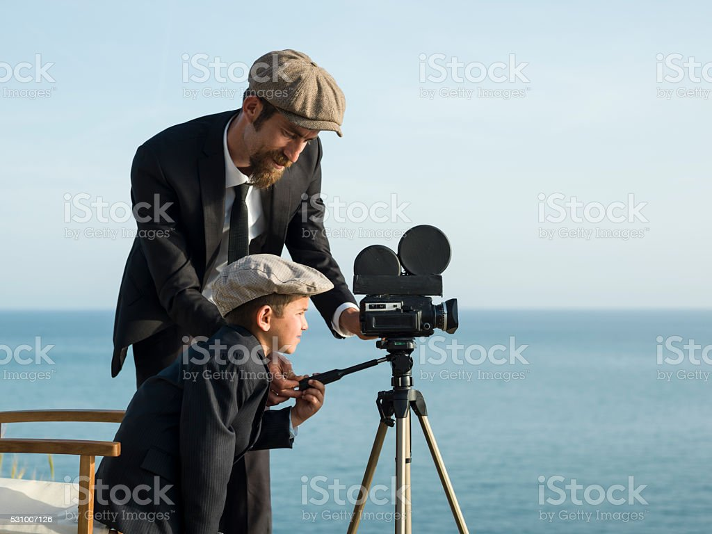 Film Director Teaching His Son How To Film Via Camera stock photo