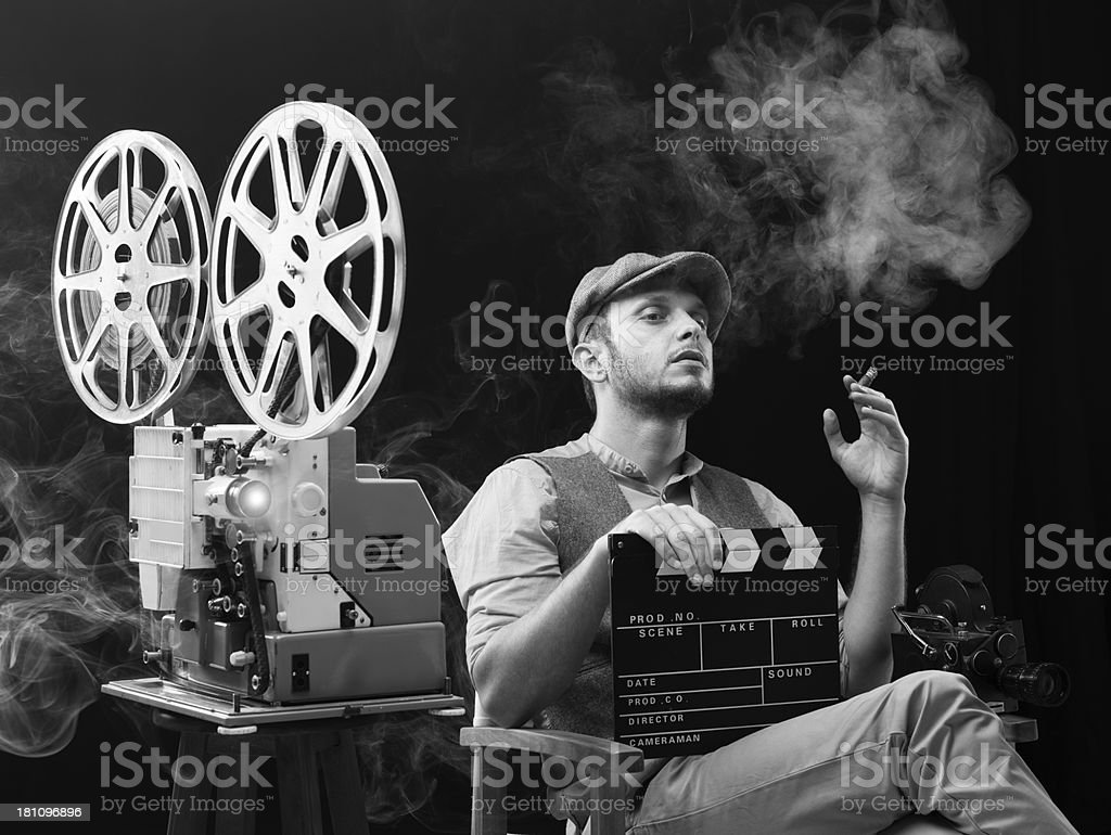 Film director watching his movie for editing stock photo