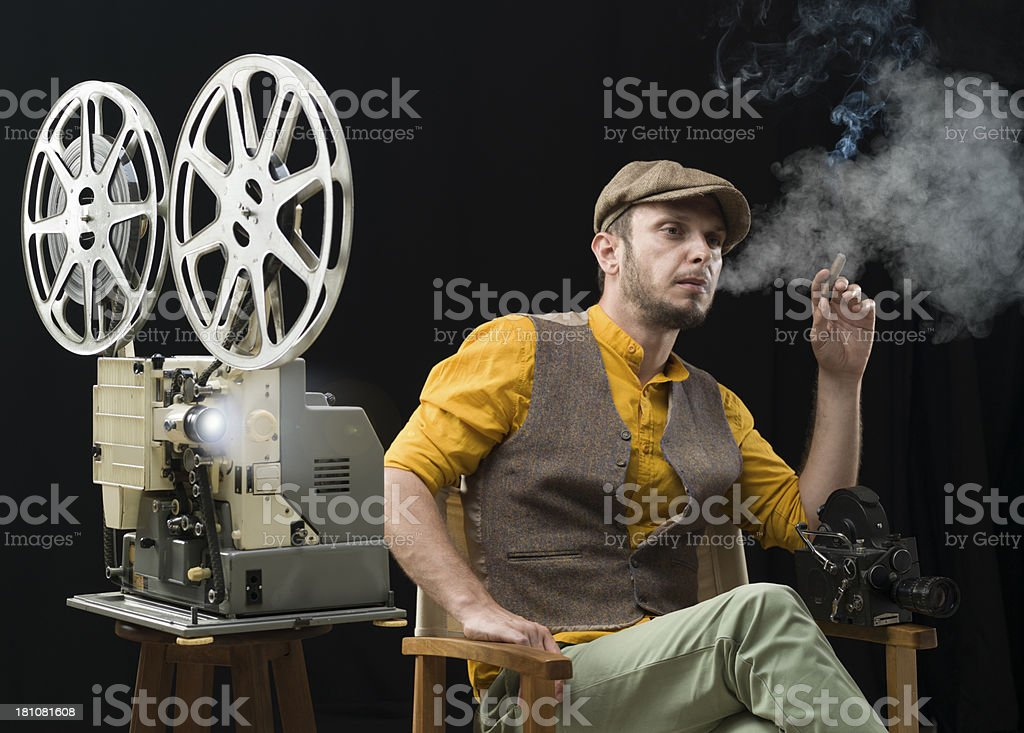 Film director watching his movie for the first time stock photo