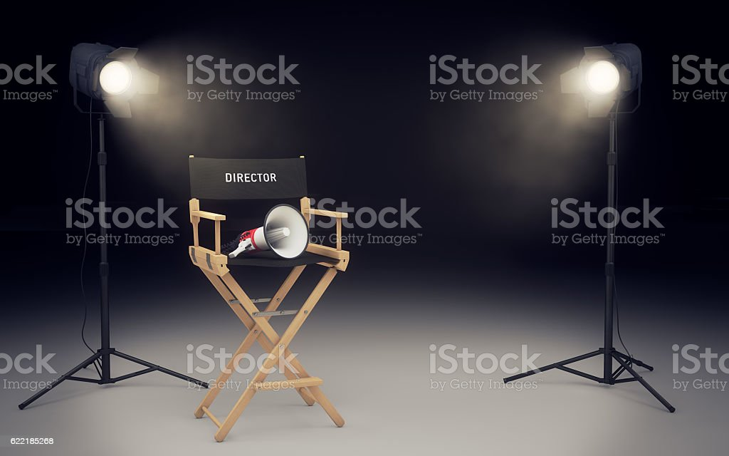Film director's chair with megaphone and spotlights. 3D renderin stock photo