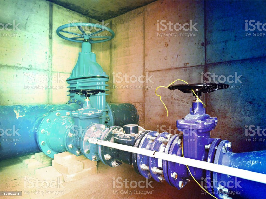 Film effect. The main City underground water shafts. 500mm large drink water pipeline with gate valve, 250mm armature  branch. stock photo