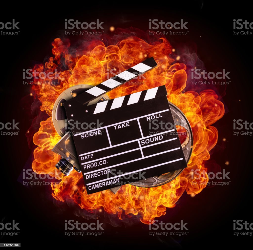 Film equipment in fire, isolated on black background stock photo