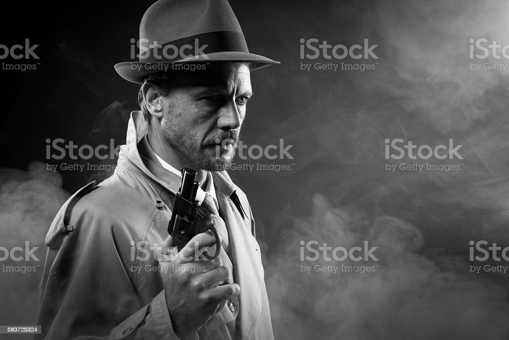 Film noir: detective in the dark with a gun stock photo