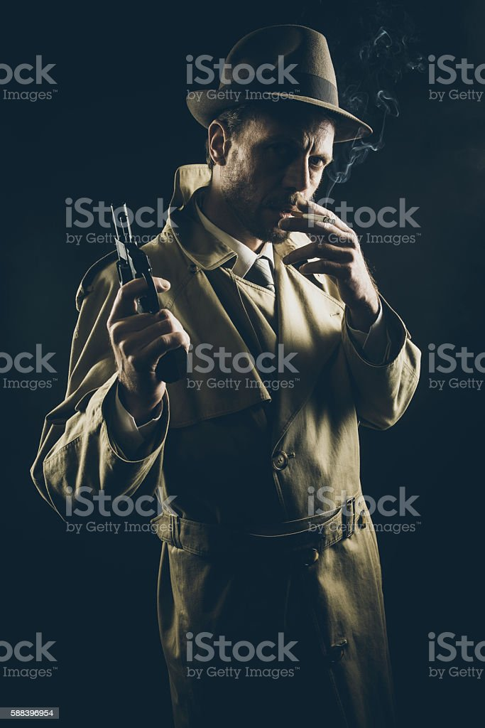 Film noir: gangster smoking and holding a gun stock photo