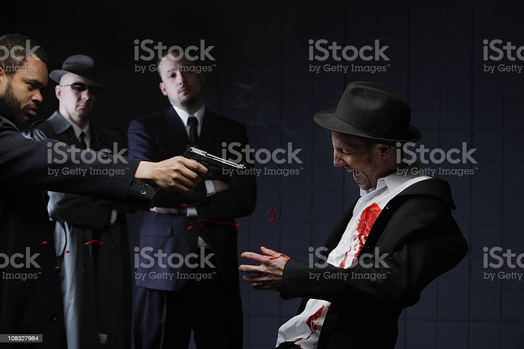 Film Noir Gun Shot with Blood Splatter stock photo