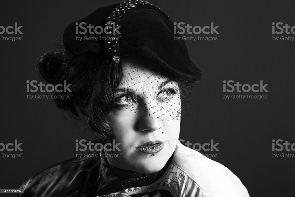 Film noir inspired B&W portrait in vintage hat. royalty-free stock photo