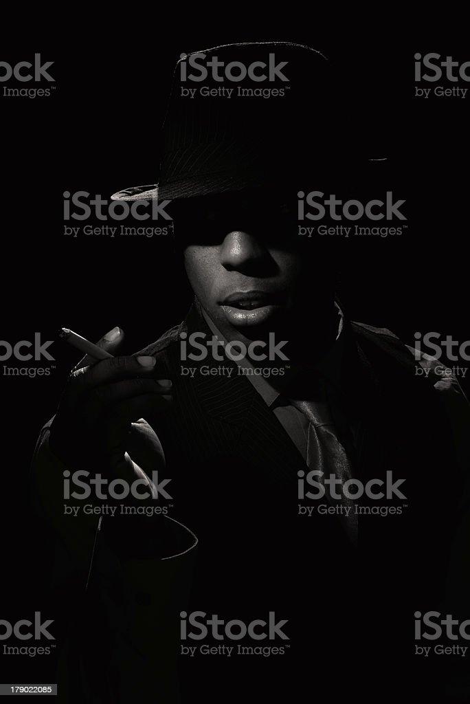 Film Noir Man Smoking Cigarette royalty-free stock photo