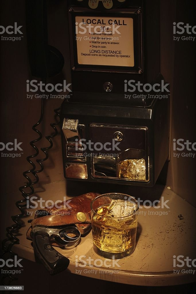 Film Noir Phone Booth - Scotch and a Holstered Revolver royalty-free stock photo