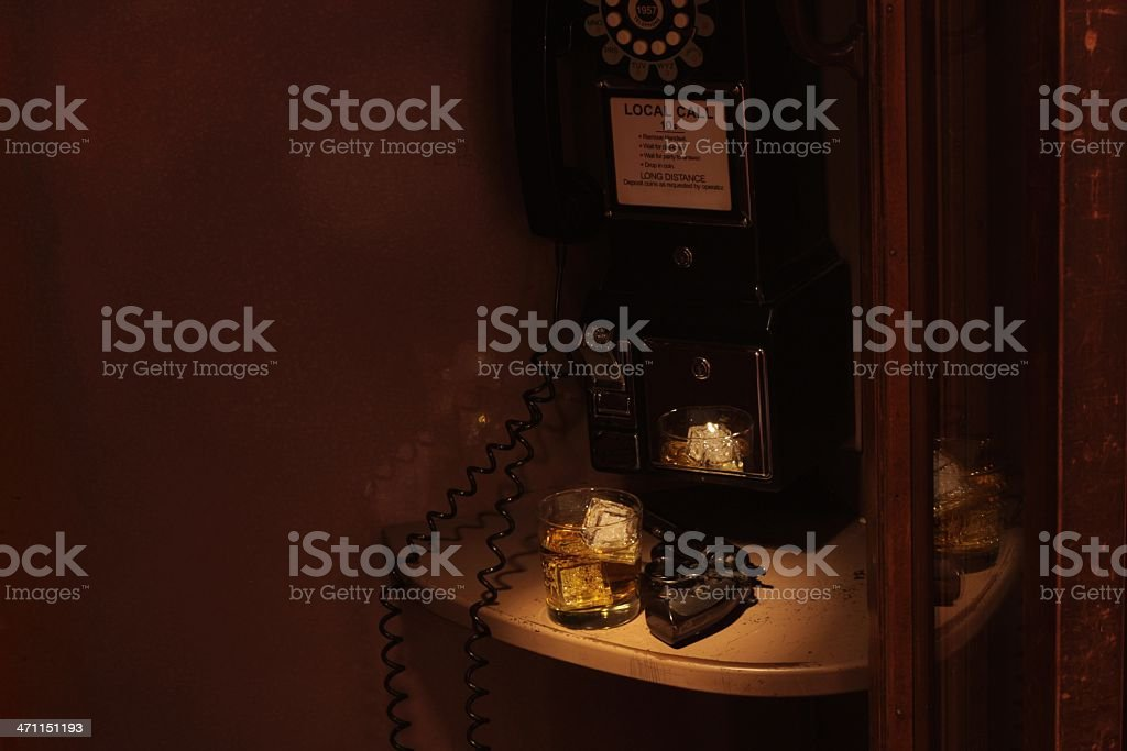 Film Noir Phone Booth - Scotch and a Revolver stock photo
