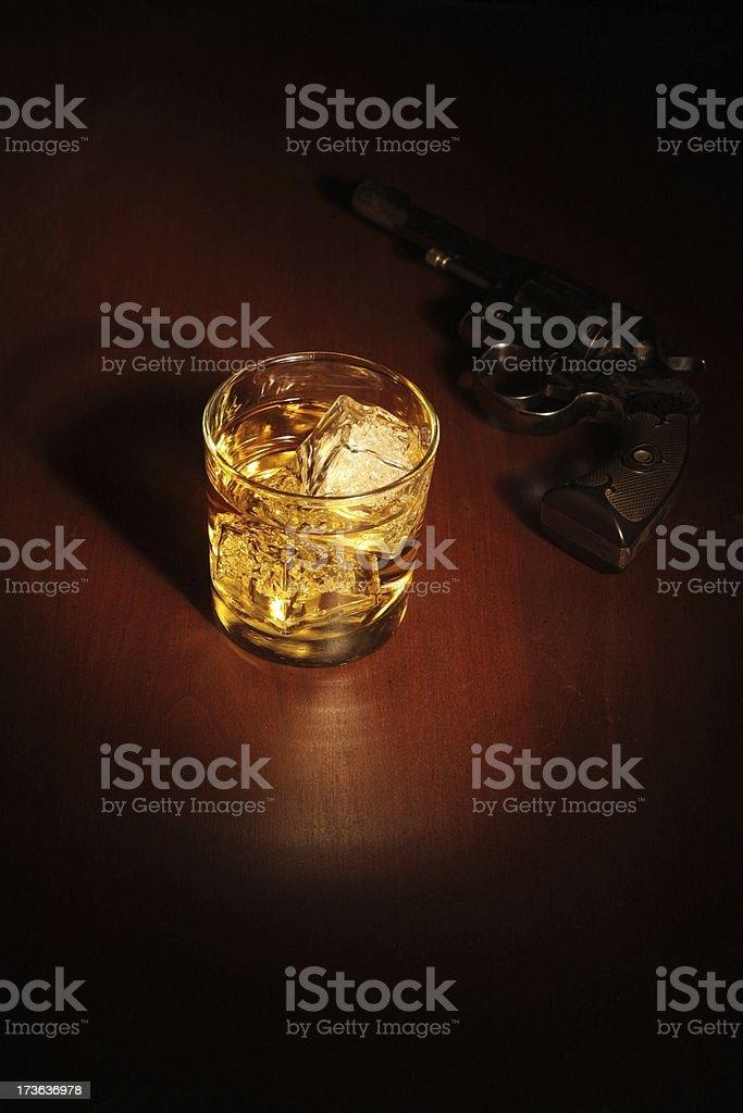 Film Noir Scotch and a Revolver royalty-free stock photo