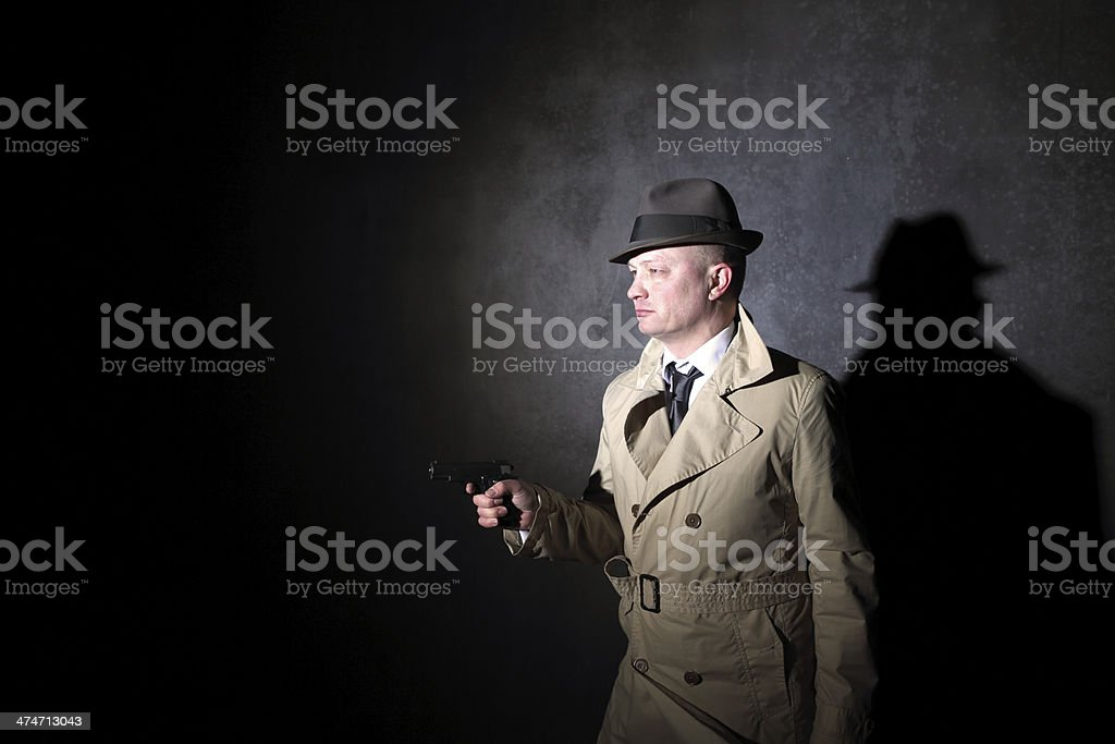 film noir style detective with a gun royalty-free stock photo
