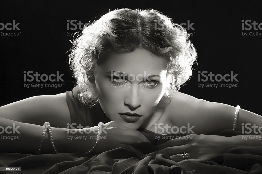 Film Noir Style.Diva with necklace stock photo