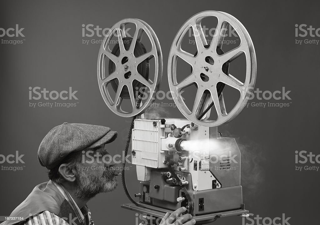 Film projectionist starting movie stock photo