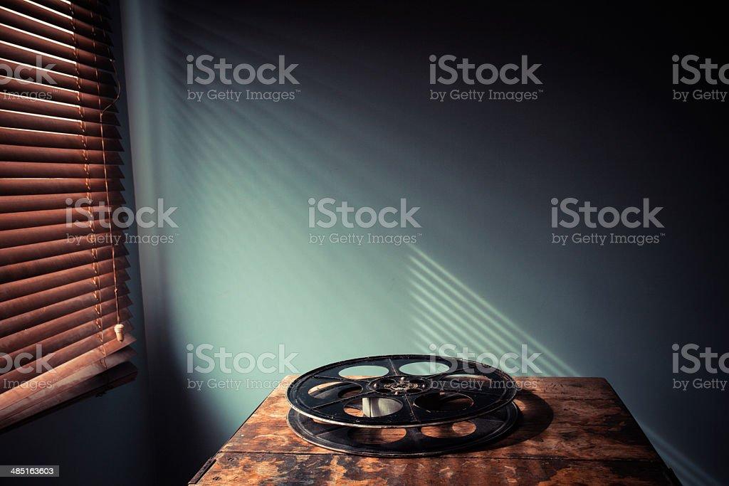 Film reel on table stock photo