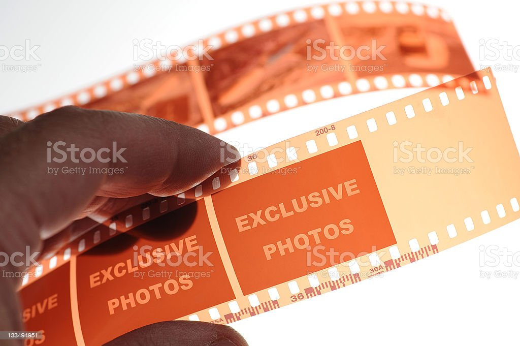 "Film strip with letter ""Exclusive photos"" royalty-free stock photo"
