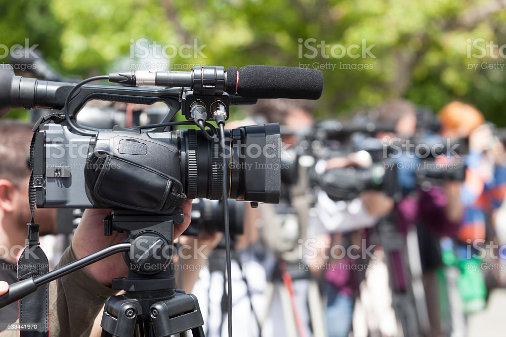 Filming an event with a video camera stock photo