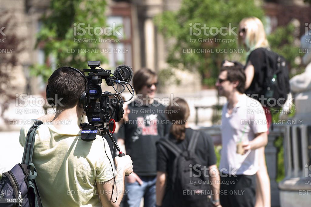 Filming group of young people stock photo