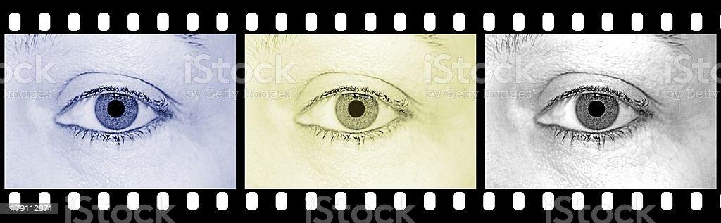 Filmstreifen mit drei Augen stock photo