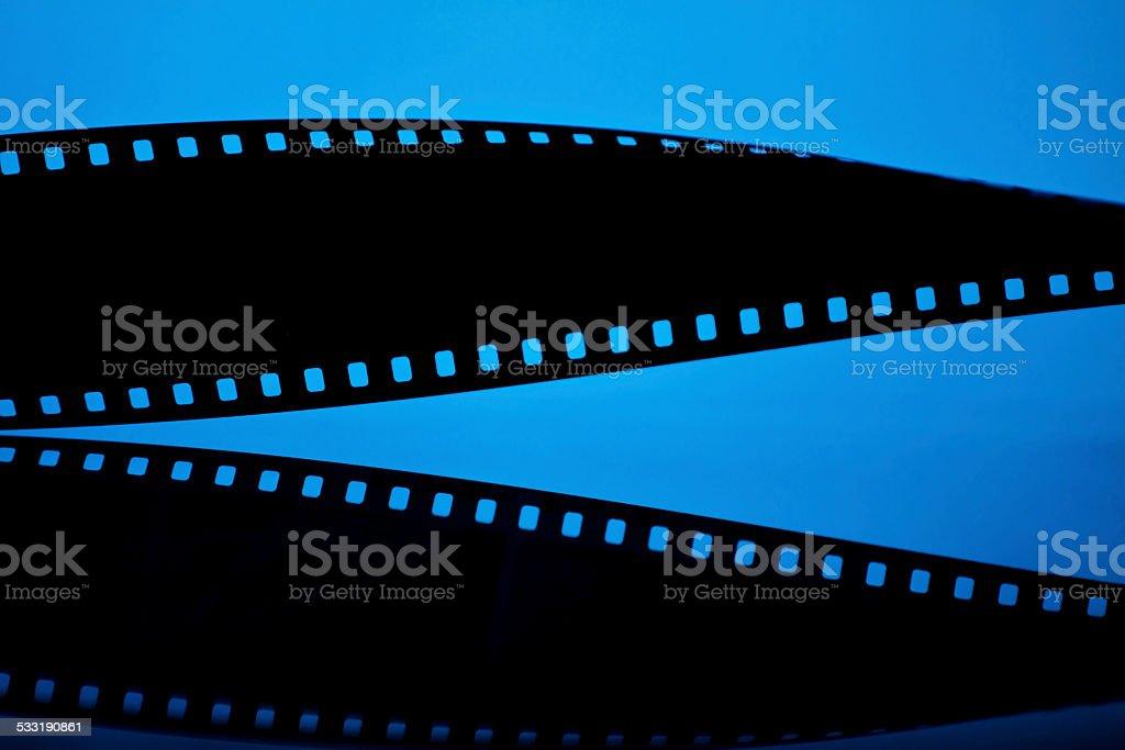 Filmstrip on blue background stock photo