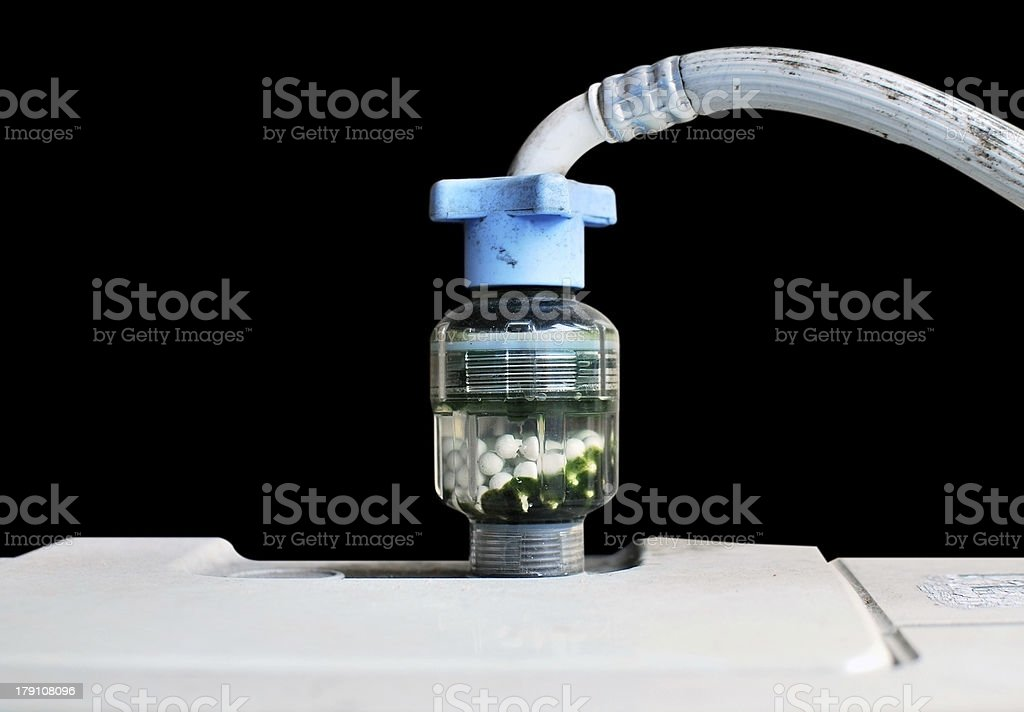 Filter flowing on wash machine royalty-free stock photo