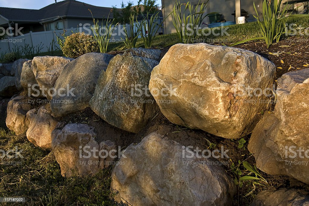 Filtered Golden Sunlight Iluminates Rock Retaining Wall stock photo