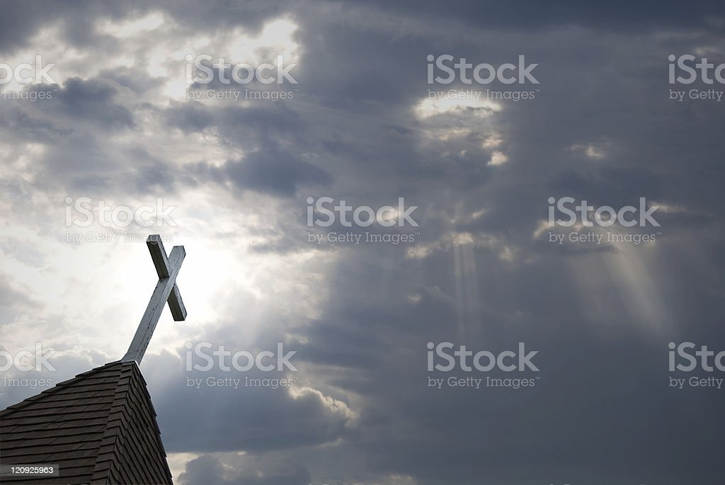 Filtered Sunlight with a White Cross and Steeple stock photo