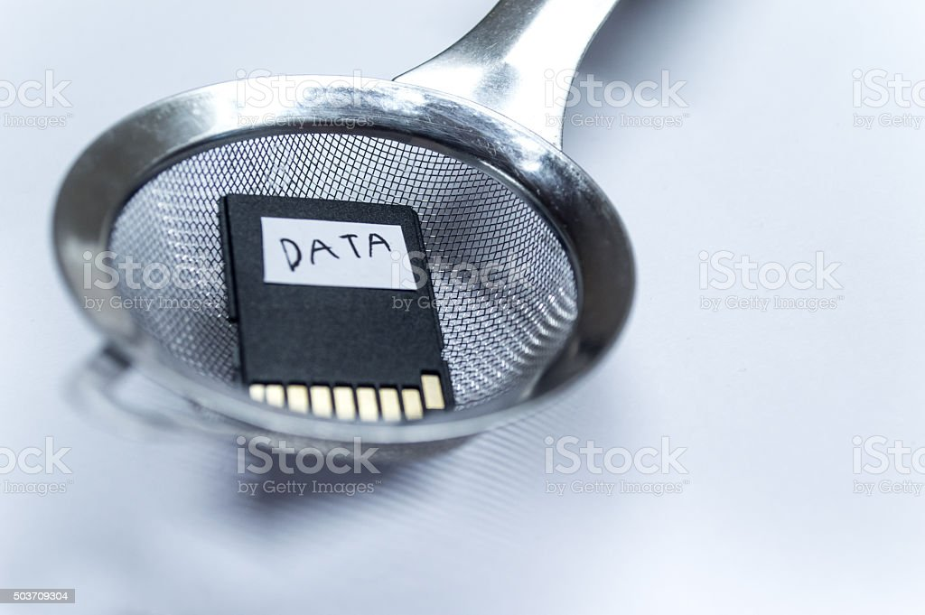 Filtering Data with a Strainer/Sieve Close Up stock photo