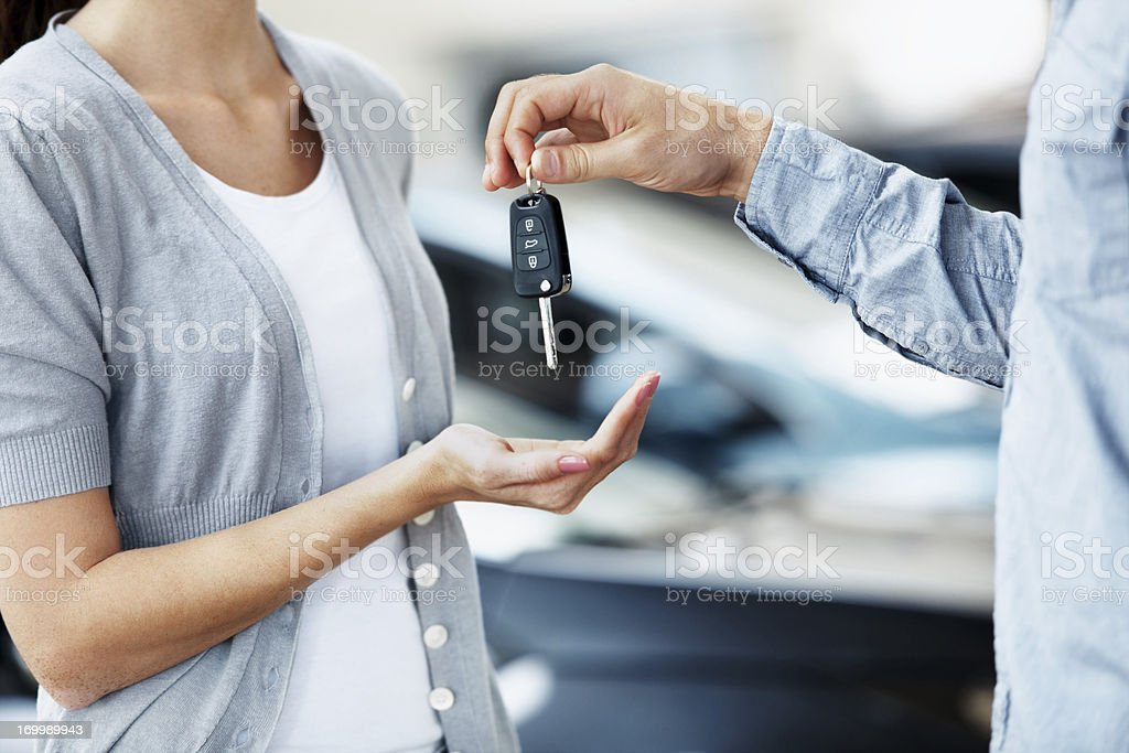 Final stage in her vehicle purchase stock photo
