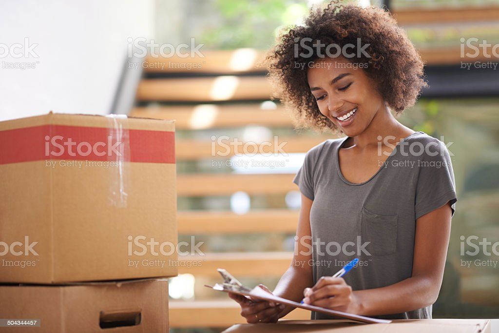 Finalising paperwork for the moving company royalty-free stock photo