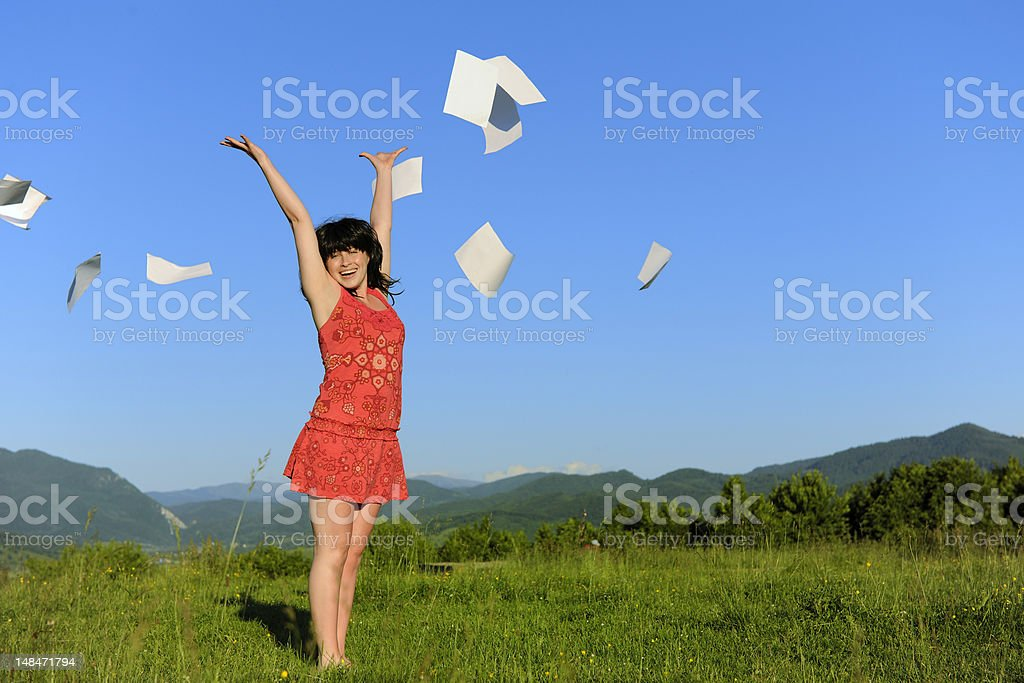 finally happy;woman throwing papers stock photo