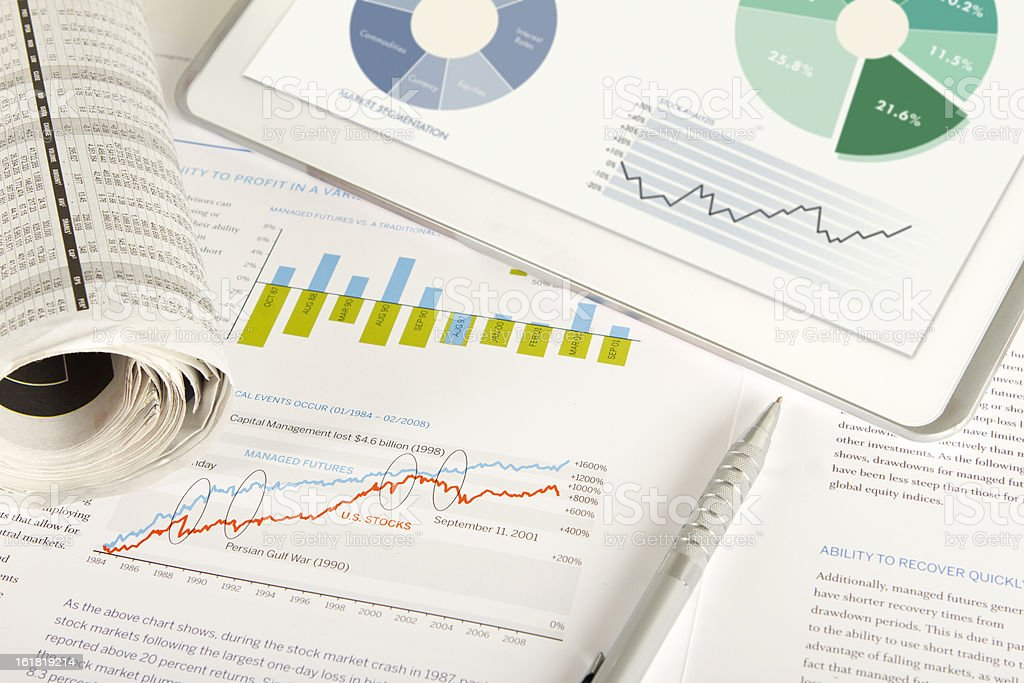 Finance analysis with printed documents stock photo