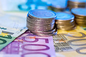 finance concept- euro coin on euro bills.
