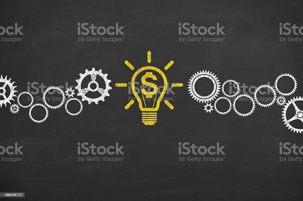 Finance Conceptual Idea Light Bulb and Gear Working on Blackboard stock photo