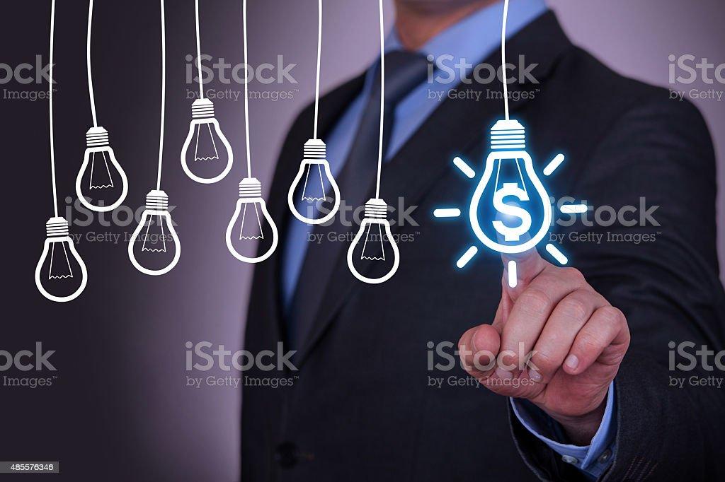Finance Idea Concept Light Bulb on Screen stock photo