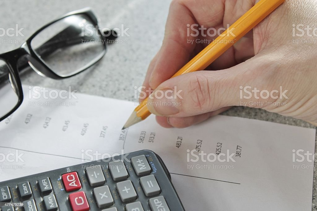 finance maths Bank statement with pencil and calculator stock photo