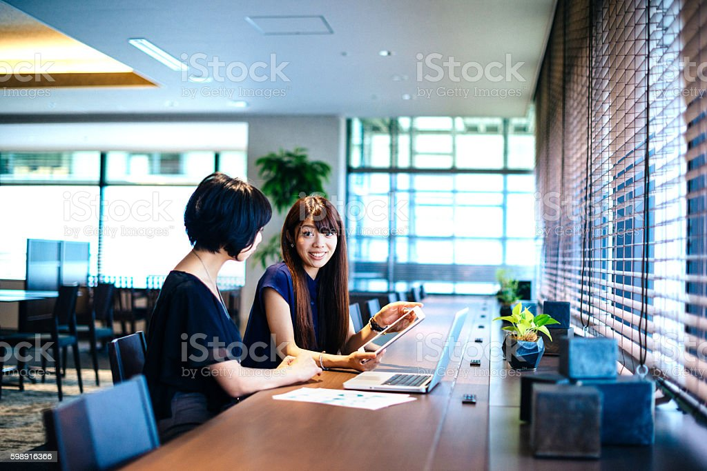 Finance minister assistants in Japan analyzing financial situation stock photo