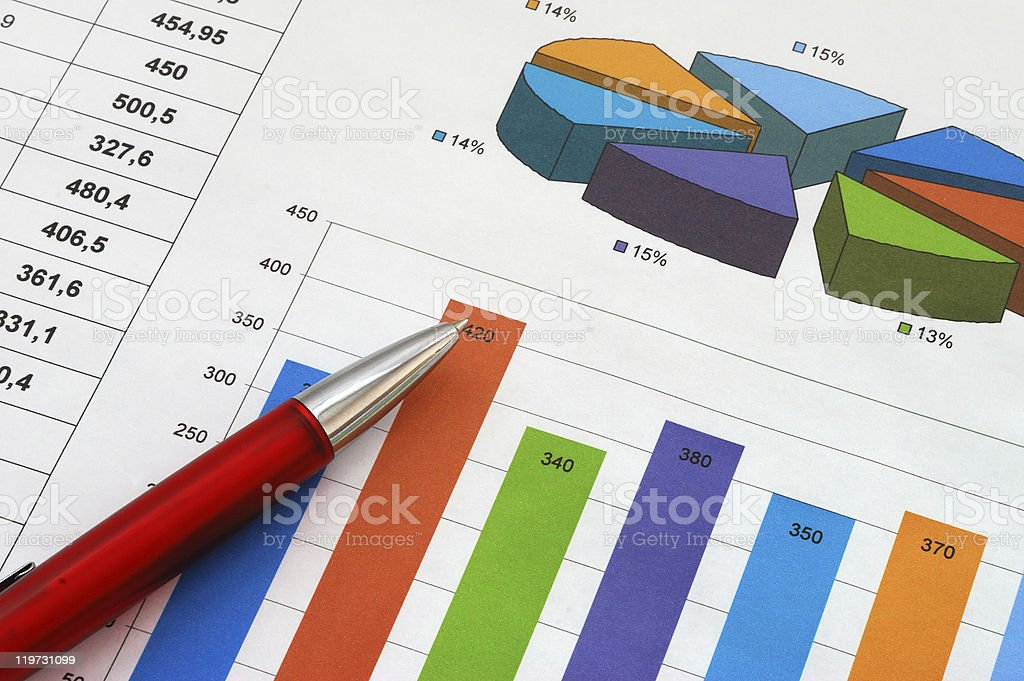 Finance report with colorful graphs and a red pen stock photo