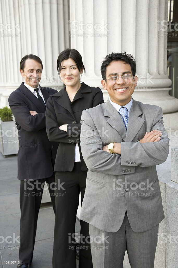 Finance team in front of building - vertical royalty-free stock photo