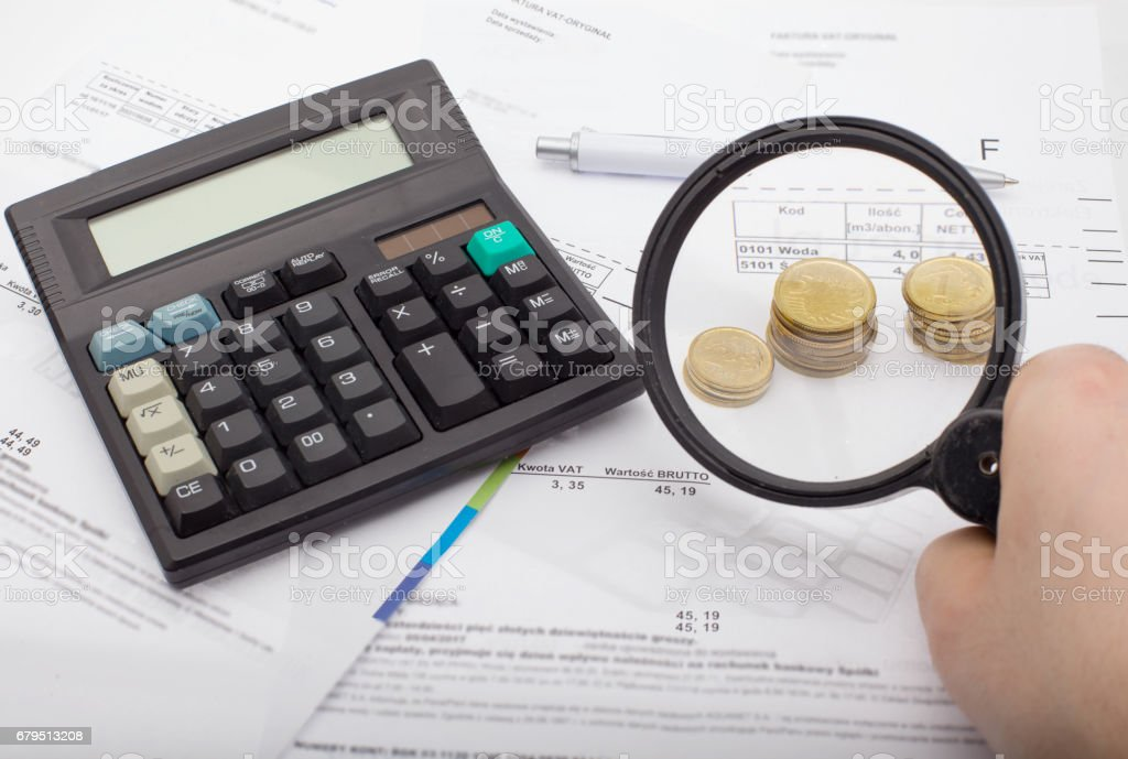 Financial accounting - searching for savings, magnifying glass stock photo