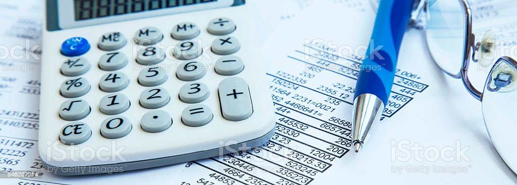 Financial accounting with paper reports and calculator stock photo