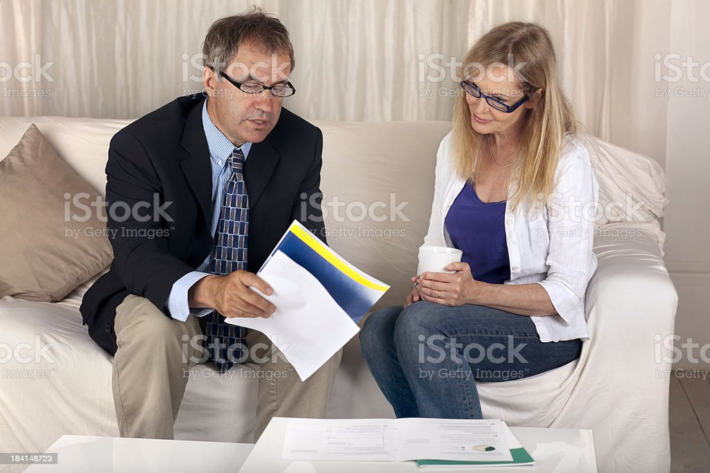 Financial Advice to mature woman royalty-free stock photo