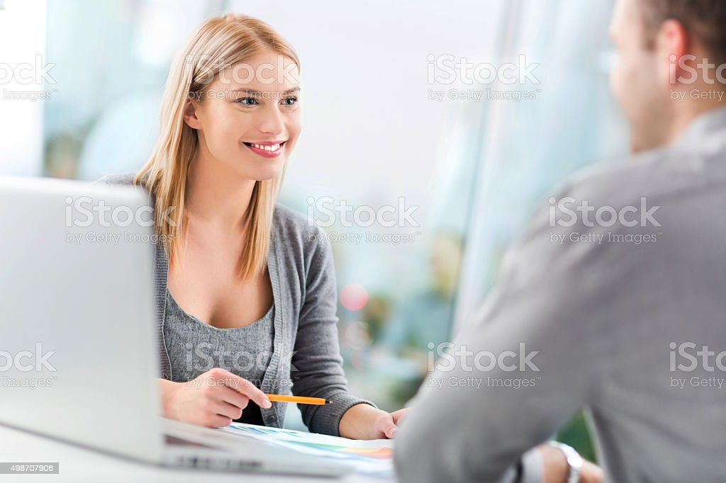 Financial adviser with a client stock photo