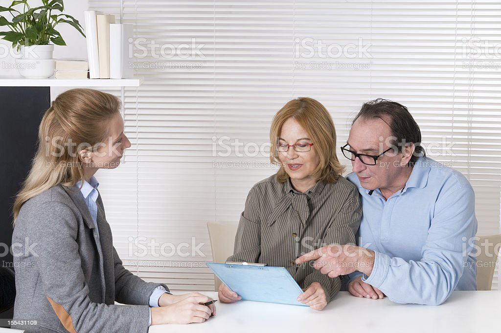 Financial Advisor and Mature Couple royalty-free stock photo