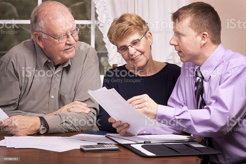 Financial Advisor Assisting Seniors (Series) stock photo
