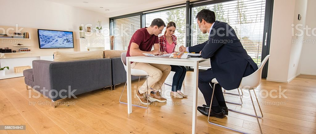 Financial advisor discussing with couple stock photo