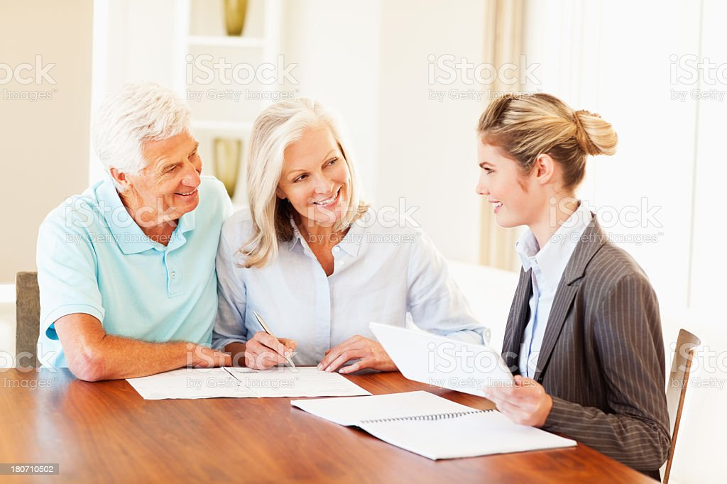 Financial Advisor Discussing With Senior Couple royalty-free stock photo