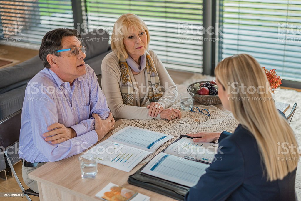 Financial advisor explaining document stock photo