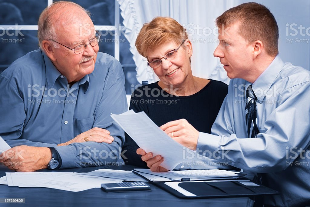 Financial advisor helping seniors stock photo