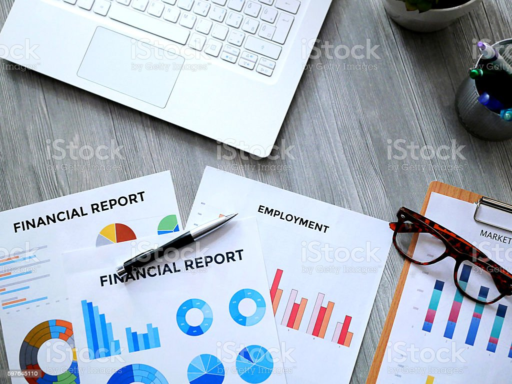 Financial advisor office with financial data and laptop stock photo